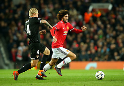 Marouane Fellaini of Manchester United goes past Simon Kjaer of Sevilla - Mandatory by-line: Robbie Stephenson/JMP - 13/03/2018 - FOOTBALL - Old Trafford - Manchester, England - Manchester United v Sevilla - UEFA Champions League Round of 16 2nd Leg