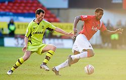 LONDON, ENGLAND - Saturday, January 30, 2010: Charlton Athletic's Jose Semedo and Tranmere Rovers' Paul McLaren in action during the Football League One match at the Valley. (Photo by Gareth Davies/Propaganda)