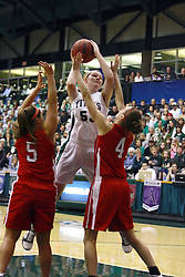 18 March 2011: Stacey Arlis gets a shot off while double teamed by Bethany Morrison and Kathryn Berger during an NCAA Womens basketball game between the Washington University Bears and the Illinois Wesleyan Titans at Shirk Center in Bloomington Illinois.