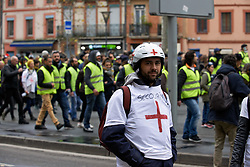 December 15, 2018 - Toulouse, France - Yellow Vest Medics (first aiders) followed the Yellow Vests demonstration to give first help to people irritated by tear gas or injured. Gendarmerie Mobile (military) and riot police fired volleys of tear gas canisters and fired rounds of flashball to disperse Yellow Jackets. Toulouse, France on December 15th 2018. (Credit Image: © Alain Pitton/NurPhoto via ZUMA Press)