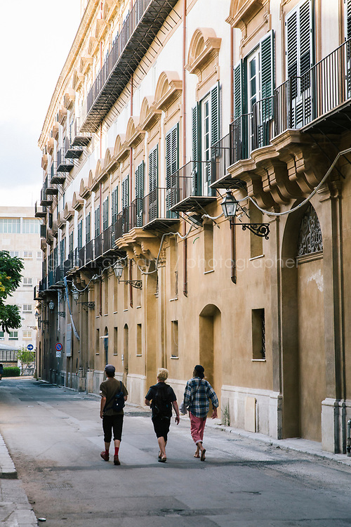 PALERMO, ITALY - 16 JUNE 2018: Visitors walk by Palazzo Butera, a venue of Manifesta 12, the European nomadic art biennal, in Palermo, Italy, on June 16th 2018.<br /> <br /> Manifesta is the European Nomadic Biennial, held in a different host city every two years. It is a major international art event, attracting visitors from all over the world. Manifesta was founded in Amsterdam in the early 1990s as a European biennial of contemporary art striving to enhance artistic and cultural exchanges after the end of Cold War. In the next decade, Manifesta will focus on evolving from an art exhibition into an interdisciplinary platform for social change, introducing holistic urban research and legacy-oriented programming as the core of its model.<br /> Manifesta is still run by its original founder, Dutch historian Hedwig Fijen, and managed by a permanent team of international specialists.<br /> <br /> The City of Palermo was important for Manifesta&rsquo;s selection board for its representation of two important themes that identify contemporary Europe: migration and climate change and how these issues impact our cities.