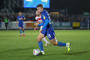 AFC Wimbledon midfielder Max Sanders (23) dribbling during the EFL Sky Bet League 1 match between AFC Wimbledon and Doncaster Rovers at the Cherry Red Records Stadium, Kingston, England on 14 December 2019.