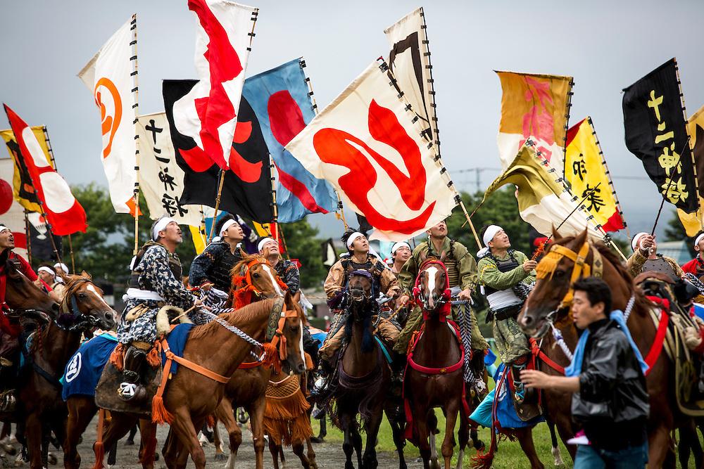 "MINAMISOMA, JAPAN - JULY 24 : A samurai horsemen fight for the sacred flag as they participate in the Shinki-soudatsusen (sacred flag competition) during the Soma Nomaoi festival at Hibarigahara field on Sunday, July 24, 2016 in Minamisoma, Japan. ""Soma-Nomaoi"" is a traditional festival that recreates a samurai battle scene from more than 1,000 years ago.  (Photo: Richard Atrero de Guzman/NURPhoto)"