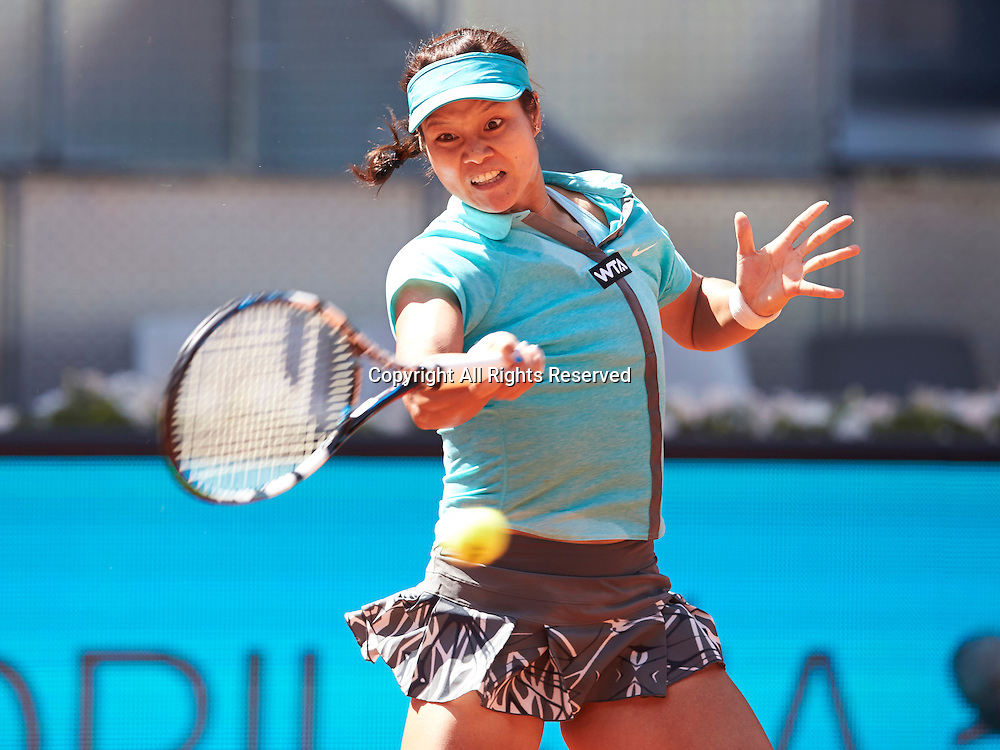 08.05.2014 Madrid, Spain. Na Li of China plays a forehand during the game with Sloane Stephens of USA on day 5 of the Madrid Open from La Caja Magica.