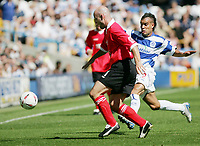 Fotball<br /> Foto: SBI/Digitalsport<br /> NORWAY ONLY<br /> <br /> QPR v Rotherham<br /> The Coca-Cola Championship at Loftus Road.<br /> 07/08/2004<br /> <br /> QPR's Marcus Bignot fights for the ball against Rotherham's Paul Shaw