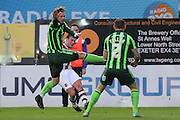 Dannie Bulman of AFC Wimbledon and Barry Fuller (Captain) of AFC Wimbledon put themselves in the firing line during the Sky Bet League 2 match between Exeter City and AFC Wimbledon at St James' Park, Exeter, England on 28 December 2015. Photo by Stuart Butcher.