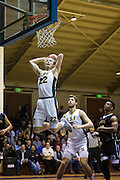 San Francisco Dons forward Chase Foster (22) dunks the ball against the San Francisco State University Gators at Kezar Pavilion in San Francisco, Calif., on December 6, 2016. (Stan Olszewski/Special to S.F. Examiner)
