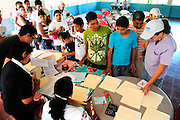 Members of the community of Nueva Esperanza registering for a day of medical tests and consultations carried out by the doctors and heath workers of the 'Nefrolempa' project, a series of investigations into the high incidence of chronic renal failure in the region.<br /> <br /> Community of Nueva Esperanza, Bajo Lempa, El Salvador. 2011<br /> The 'Nefrolempa' research project is a collaboration between the El Salvador Ministry of Health, the Nephrology Institute of Cuba's Ministry for Public Health and the United Bajo Lempa Committee Association. The aim of the project is to investigate the reasons for the high levels of Chronic Kidney Disease (CKD) suffered by the communities within the Bajo Lempa region. It is exploring whether the use of agrochemicals might be a factor in the prevalence of the disease.