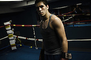 BETHLEHEM, PA – MAY 31, 2011: Seventeen year-old Cody Coronado trains with athletic coach Tom Gazzana at the Bethlehem Boxing Club, located at 502 East 4th Street in Bethlehem, Pennsylvania. Coronado is half caucasian, half dominican.<br />
