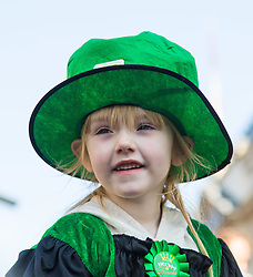 London, March 13th 2016. The annual St Patrick's Day Parade takes place in the Capital with various groups from the Irish community as well as contingents from other ethnicities taking part in a procession from Green Park to Trafalgar Square.  PICTURED: A little girl in a giant Irish hat watches the procession. ©Paul Davey<br /> FOR LICENCING CONTACT: Paul Davey +44 (0) 7966 016 296 paul@pauldaveycreative.co.uk