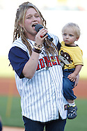 MAY 14, 2010: American Idol Crystal Bowersox sings the National Anthem with her son Tony before the Toledo Mudhens MiLB baseball game during her hometown celebration in Toledo, Ohio.