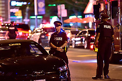 Police work at the scene of a mass casualty incident in Toronto, ON, Canada on Sunday, July 22, 2018. A young woman has been killed and 13 others injured in a shooting incident in Toronto, Canadian police say. The Sunday night shooting happened in the Danforth and Logan avenues area. The gunman died in an exchange of fire. Among those injured is a young girl, described as in a critical condition. Police are appealing for witnesses. Photo by Frank Gunn/ABACAPRESS.COM