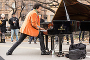 ELEW, Eric Lewis, typically plays with legs spread. He played near the reservoir on the west side of Central Park.