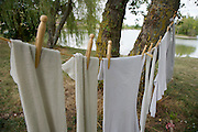 clothing hanging to dry at a lake pinned to a line with old style clothespins