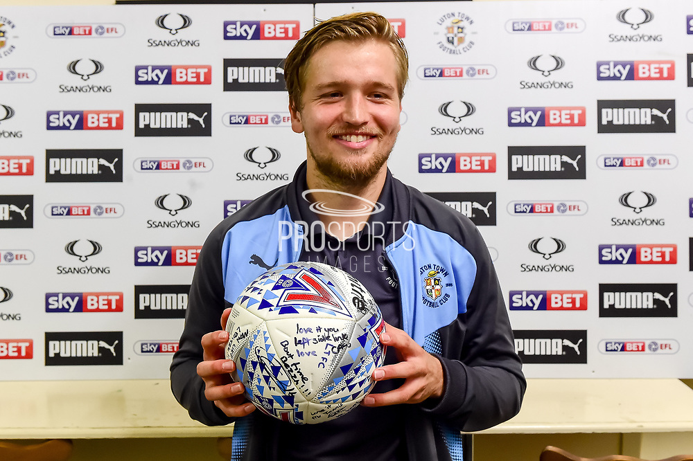 Luton Town midfielder Luke Berry (18) poses with the match ball , signed by his team mates following his perfect hat trick during the EFL Sky Bet League 2 match between Luton Town and Stevenage at Kenilworth Road, Luton, England on 14 October 2017. Photo by Dennis Goodwin.