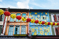 The colorful facades of shophouses in Chinatown, Singapore.