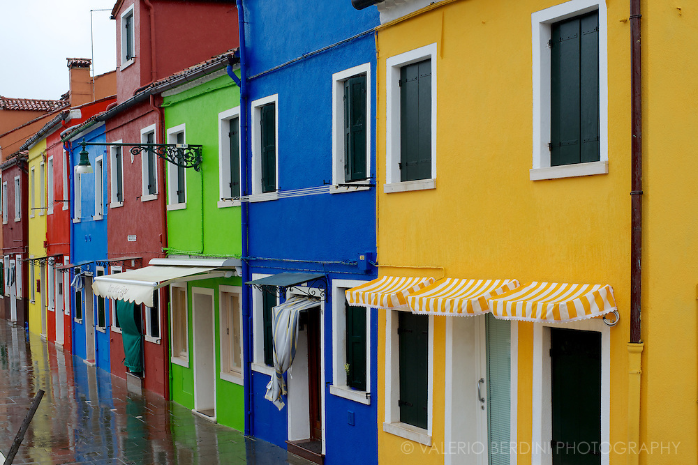 The Island of Burano, part of the Venetian lagoon in the North East of Italy is famous for its bright painted houses. The city council controls the colour palette, owner are not allowed to change the house colour without permission.
