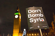 UNITED KINGDOM, London: 02 December 2015 Thousands of people gather in Parliament Square this evening as part of a Stop The War campaign. Protesters have gathered outside Parliament for a second night as they await the result of a vote on UK air strikes in Syria. Rick Findler / Story Picture Agency