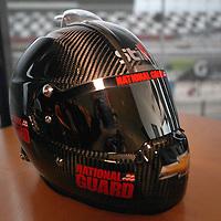 The new helmet of driver Dale Earnhardt Jr. rests on the table during the NASCAR Media Day event at Daytona International Speedway on Thursday, February 14, 2013 in Daytona Beach, Florida.  (AP Photo/Alex Menendez)