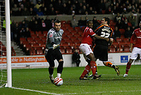 Photo: Richard Lane/Richard Lane Photography. Nottingham Forest v Blackpool. Coca Cola Championship. 13/12/2008. Ben Burgess (R) glances his header past Wes Morga (C) and the far post. Keeper Lee Camp looks on