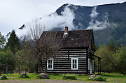 Bull River Guard Station and the Cabinet Mountains, one of the original ranger stations in the Kootenai National Forest now restored and used as a rental cabin. Northwest Montana.