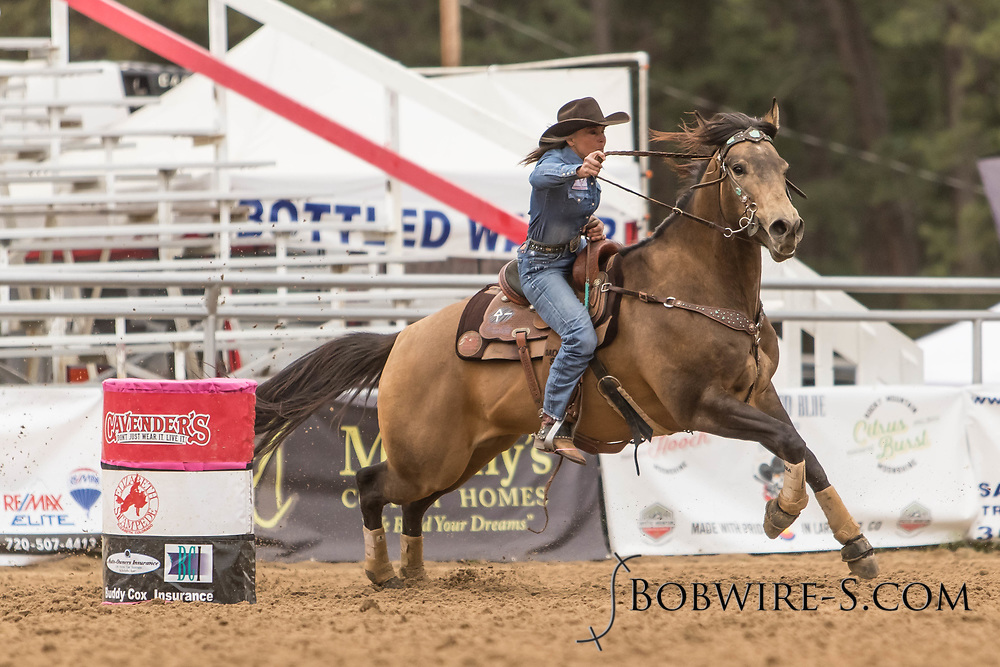 Kim Schulze makes her barrel racing run during slack at the Elizabeth Stampede on Sunday, June 3, 2018.