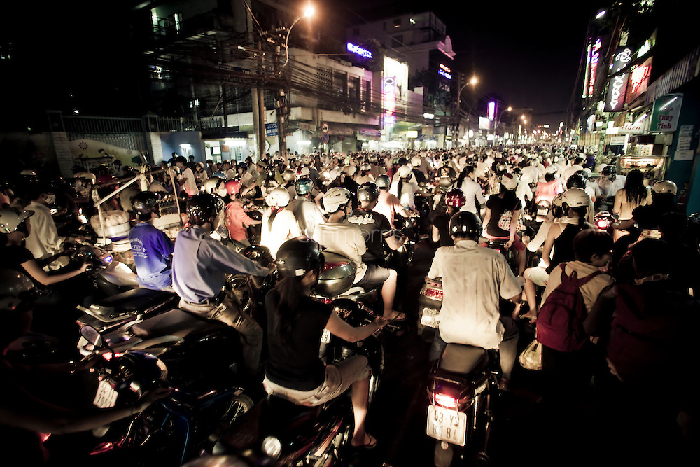 Rush hour in Saigon has a pace slower than walking, leaving the air acrid with exhaust fumes