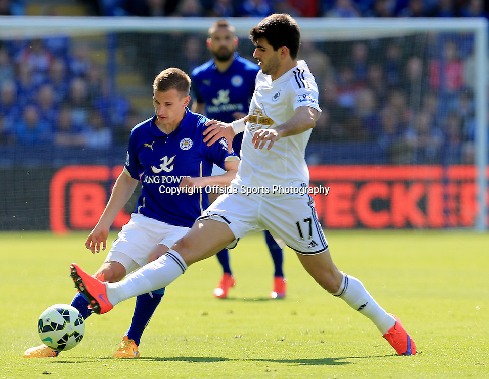 18th April 2015 - Barclays Premier League - Leicester City v Swansea - Marc Albrighton of Leicester City chips the ball past Nelson Olivera of Swansea City - Photo: Paul Roberts / Offside.