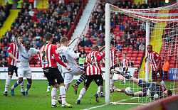 SHEFFIELD, ENGLAND - Saturday, March 17, 2012: Tranmere Rovers' Lucas Akins [hidden] scores the equalising goal past Sheffield United's goalkeeper Steve Simonsen to level the scores 1-1 during the Football League One match at Bramall Lane. (Pic by David Rawcliffe/Propaganda)