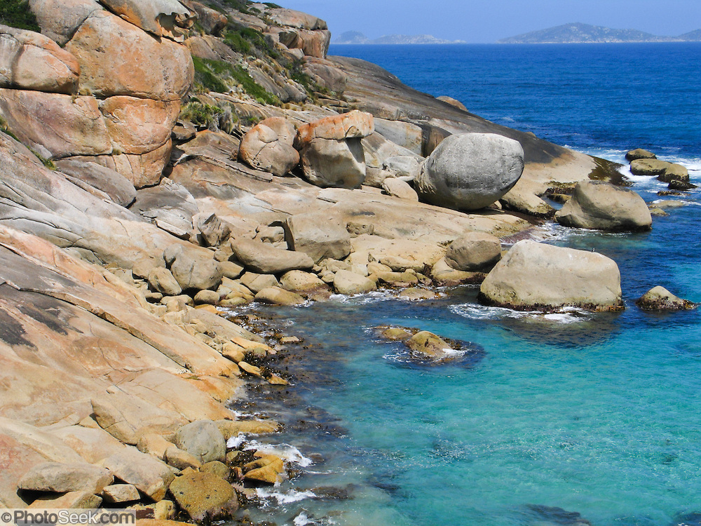 "The Indian Ocean (or Southern Ocean according to Australian geographers) washes onto granite shoreline at Wilson's Promontory National Park in the Gippsland region of Victoria, Australia. Drive two hours from Melbourne to reach Wilson's Promontory, or ""the Prom,"" which offers natural estuaries, cool fern gullies, magnificent and secluded coastal beaches, striking rock formations, and abundant wildlife."