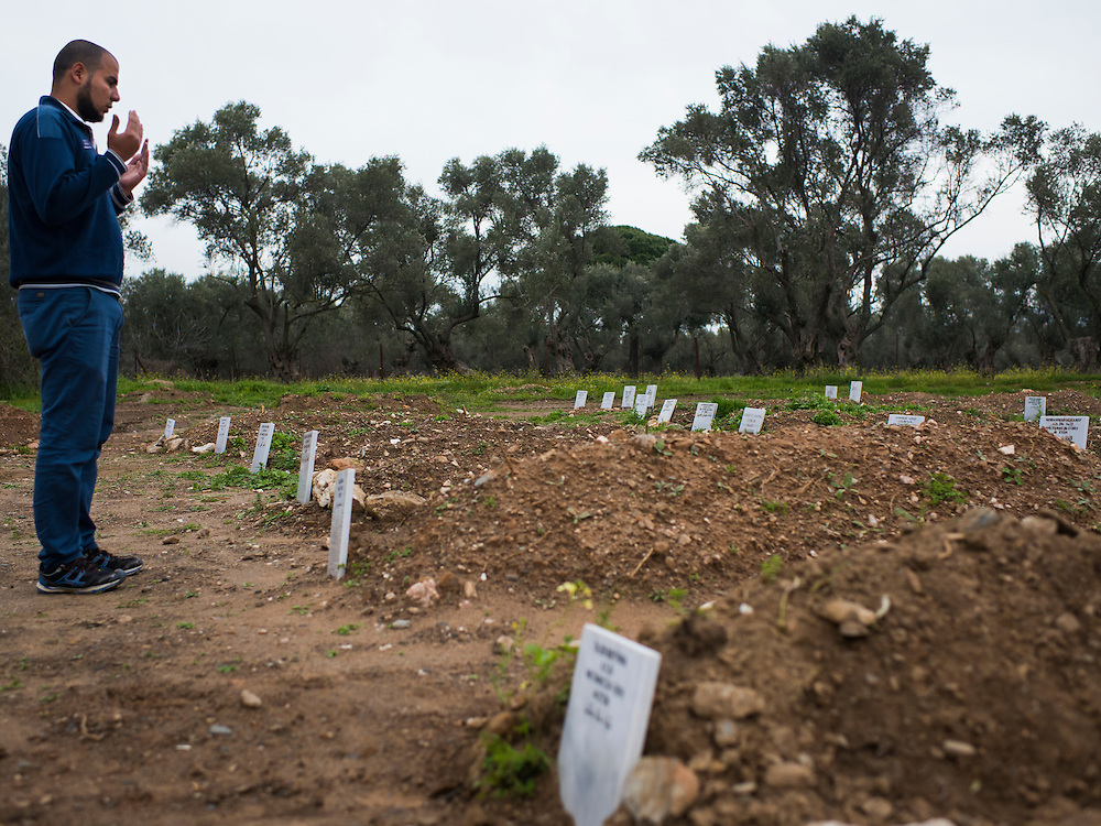 Mustafa Dawa, who has voluntarily taken on the responsibility of providing Muslim burials to the refugees who die attempting to cross the Aegean Sea from Turkey, says a quick prayer over the nearly 70 graves he's dug so far on March 13, 2016 near Michos, Greece. The graveyard is built on land provided by local authorities after an original cemetery reached capacity, leaving bodies to languish in the local morgue.