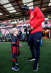 Crystal Palace's Wilfried Zaha signs an autograph for a young fan ahead of the match