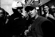 Press workers spectating the situation as police trying to seal off street and making the arrest during the anti-war protest, San Francisco, 2003