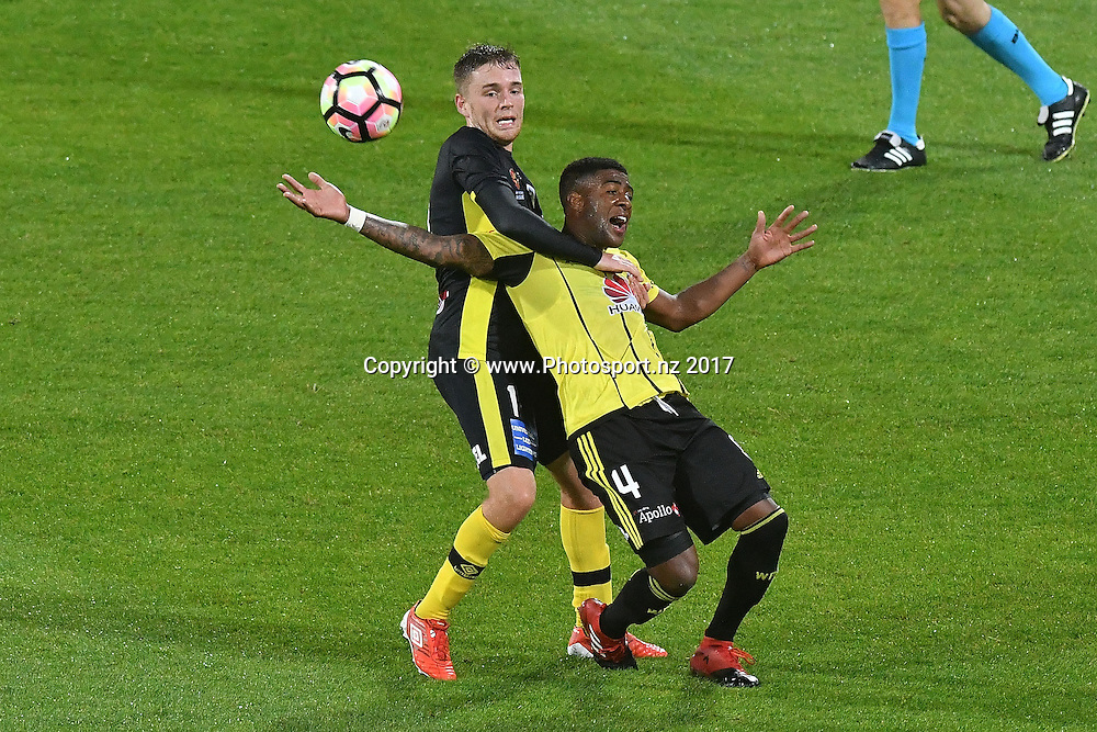 Phoenix's Rolieny Bonevacia (R is tackled by Mariners' Connor Pain during the A-League - Phoenix v Central Coast Mariners football match at Westpac Stadium in Wellington on Saturday the 14 January 2017. Copyright Photo by Marty Melville / www.Photosport.nz
