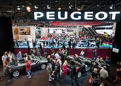 View of crowds at Peugeot display at Paris Motor Show 2010
