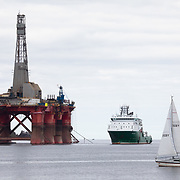 Greenpeace activists board a BP oil rig in Cromarty Firth to stop it from further oil drilling at sea, June 10th 2019, Cromarty, Scotland, United Kingdom. The oil rig 'Paul B. Loyd, Jnr', owned by Transocean, was due to head to BP's Vorlich field, 150 miles (241km) east of Aberdeen to drill for oil for BP. The occupation by Greenpeace activists subsequently delayed the departure for 5 days and 14 activists were arrested in the process. Greenpeace says that in an age of climate emergency BP should not be drilling for new oil but look for non-fossil fuel means of energy.