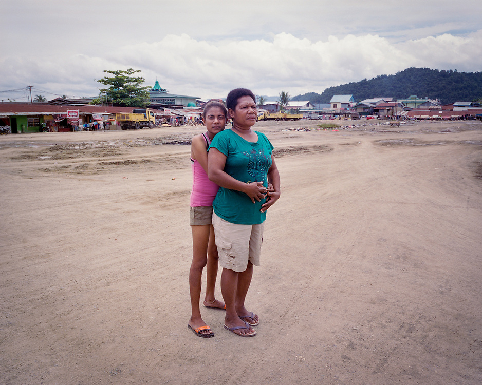Portrait Series.<br /> <br /> A portrait of a street prostitute, Violeta (19), with Mama Fin, a social worker from Mother's Hope Foundation