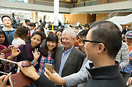 University of Chicago Booth professor Richard Thaler, winner of the 2017 Nobel Prize in Economics, poses with members of the crowd that gathered to see his press conference.  (photo by Anne Ryan)