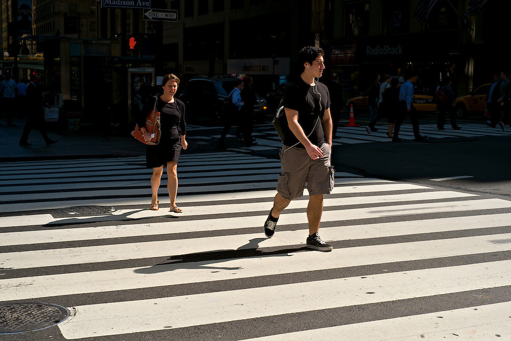 Two people crossing street