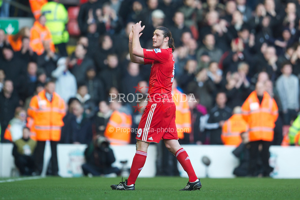LIVERPOOL, ENGLAND - Sunday, March 6, 2011: Liverpool's Andy Carroll applauds the supporters after making his debut during the Premiership match against Manchester United at Anfield. (Photo by David Rawcliffe/Propaganda)