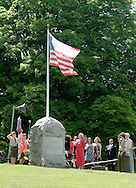 Hamptonburgh, NY -  People salute the flag during Memorial Day ceremonies at Hamptonburgh Cemetery  on May 25, 2009.