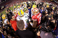 12 January 2013: Quarterback (7) Colin Kaepernick of the San Francisco 49ers greets (12) Aaron Rogers of the Green Bay Packers after the 49ers 45-31 victory over the Packers in an NFL Divisional Playoff Game at Candlestick Park in San Francisco, CA.