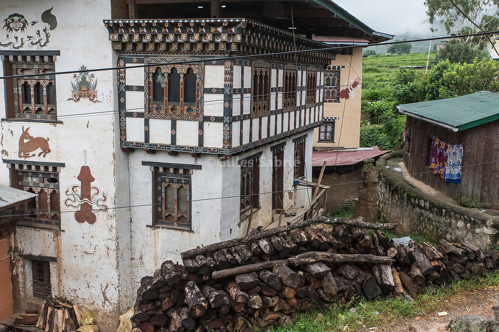 For a story by Steven Lee Myers, Bhutan<br /> Lobesa, Bhutan, August 2nd, 2017<br /> Houses in Lobesa village adorned with mural paintings of a phallus. Locals believe that the phallic symbols bring good luck and drives away evil spirits, Its origin can be found in the Bon religion that predated the advent of Tibetan Buddhism. Phallus representations are also linked to the XVIth century Lama Drukpa Kunley  popularly known as the &ldquo;Divine Madman&rdquo; for his unorthodox ways of teaching, and for his bizarre and shocking behaviours.<br /> Gilles Sabri&eacute; pour The New York Times