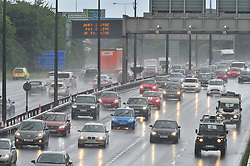 © Licensed to London News Pictures. 22/07/2017<br /> Traffic queuing Anti-clockwise on the M25 in Kent at the Dartford Crossing.<br /> Drivers face wet weather conditions as the great summer holiday weekend getaway continues today with millions of drivers taking to the UK's roads. <br /> Photo credit: Grant Falvey/LNP