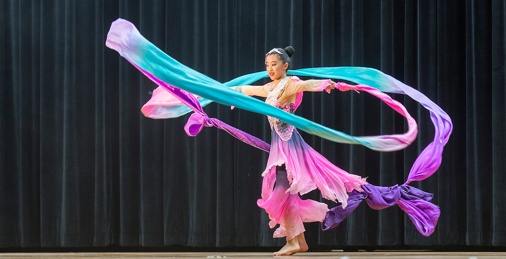 "Lanier Middle School student, Shiyu Zhang performs ""Dancing on a Cloud"", during a district wide celebration of the Chinese New Year at Sharpstown International School, February 22, 2014."