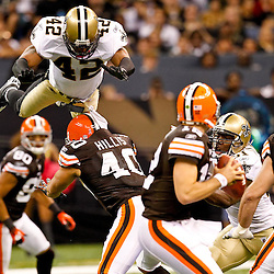 Oct 24, 2010; New Orleans, LA, USA; New Orleans Saints safety Darren Sharper (42) is upended by Cleveland Browns running back Peyton Hillis (40) as he blitzes the quarterback during the second half at the Louisiana Superdome. The Browns defeated the Saints 30-17.  Mandatory Credit: Derick E. Hingle