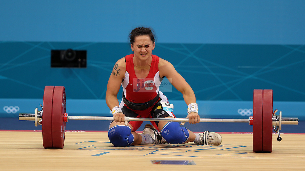 Begaj Romela of Albania fails to lift 121kg during the women's 58kg weightlifting event during day 3 of the London Olympic Games London, 30 Jul 2012..(Jed Jacobsohn/for The New York Times)....