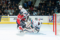 KELOWNA, CANADA - FEBRUARY 2: Egor Babenko #22 of Lethbridge Hurricanes is checked by Braydyn Chizen #22 in front of the net of Michael Herringer #30 of Kelowna Rockets on February 2, 2016 at Prospera Place in Kelowna, British Columbia, Canada.  (Photo by Marissa Baecker/Shoot the Breeze)  *** Local Caption *** Braydyn Chizen; Michael Herringer; Egor Babenko;