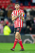 Jack Baldwin (#15) of Sunderland AFC applauds the fans after the final whistle of the EFL Sky Bet League 1 match between Sunderland AFC and Luton Town at the Stadium Of Light, Sunderland, England on 12 January 2019.