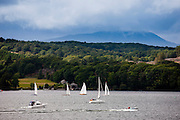 Sailing yachts, motor launch and speedboat on Lake Winderemere viewed from Troutbeck towards Hawkshead in the Lake District National Park, Cumbria, UK